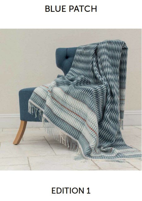 Cover Image of throw on blue chair for Blue Patch Magazine